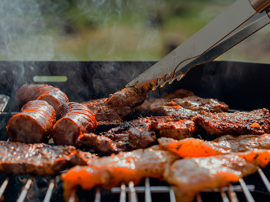 meat grilling on a custom built stainless steel bbq grill